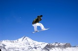Fototapeta snowboarder jumping high in the air