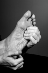 reflexology massage on aged foot