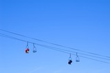 skiers and snowboarders in a chairlift