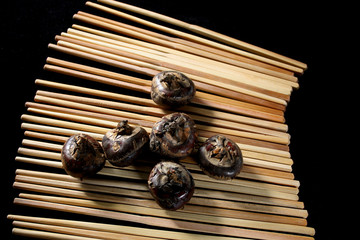 water chestnuts on chopsticks