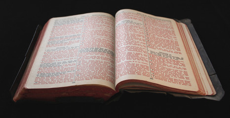 old bible with red text