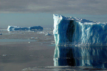 two blue antarctic icebergs