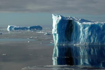 two blue antarctic icebergs