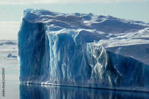 Leinwanddruck Bild blue antarctic iceberg