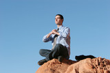 young businessman meditating poster