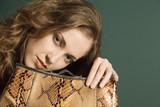 pretty woman with handbag poster