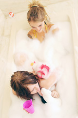 young women takin a bubble bath