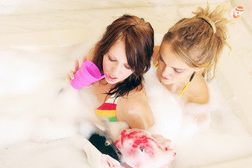 two young women in bathtub