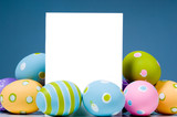 Fototapety brightly colored easter eggs surrounding white, blank notecard