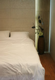 double bed with white sheets and pillows poster