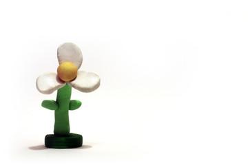 lone white plasticine flower