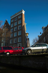 cars by the canal in amsterdam