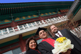 university graduate with his parents poster