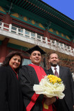 graduation day for an international student at an asian universi poster