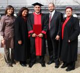 happy university graduate with his parents. international studen poster