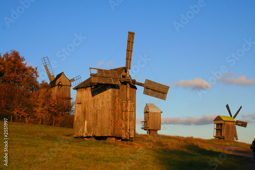 windmill at autumn landscape