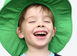 the happy boy in a green hat