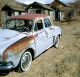 old rusty renault dauphine in  ghost town poster