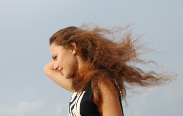 beautiful young girl with long hair and wind