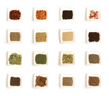 various kinds of spices in white square bowl poster