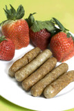 pork sausage links with strawberries poster