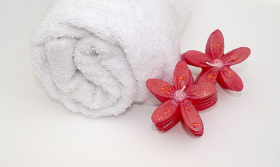 flower candles and towel