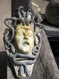 sculpture of  snakes biting a man.torture.scream. poster