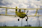 bi-plane crop dusting a field poster