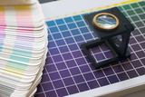 table of color with magnifier lens poster