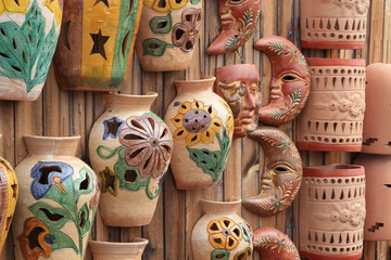 pottery display on a wooden fence