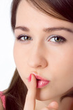 beauty girl hold finger fron mouth and say sh poster