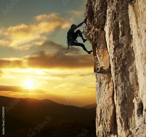 Fotobehang Extreme Sporten climber on sunset