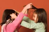 girls touching hair poster