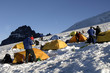 mountain climbers and their tents