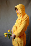 pregnant woman holding her belly and yellow tulips poster