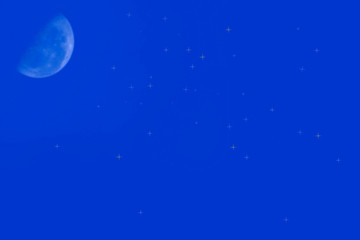 moon and stars in blue sky