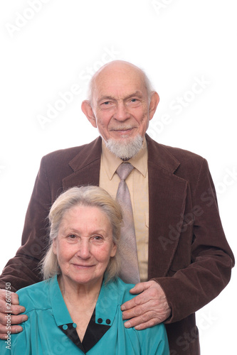 senior couple, man embracing shoulders of his wife, isolated on