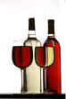 red and white wine glasses with bottles