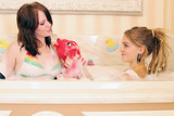 young women in bathtub poster