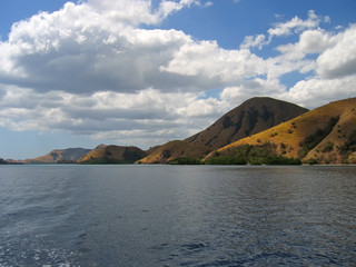 mountains falling on the sea, komodo archipelago, indonesia