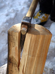 an axe splitting wood
