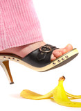 female leg(foot) and peel of a banana. life insurance. poster