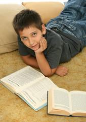 boy reading  books on the floor