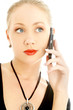 portrait of elegant blond using cellular phone