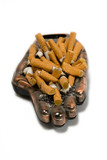 ashtray with many cigarette on a white background poster