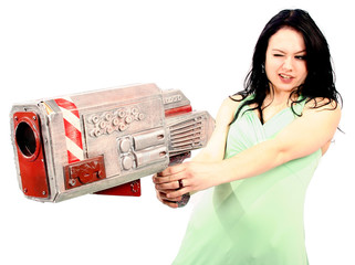 crazy woman in green dress with huge laser weapon gun