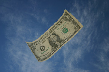 dollar against blue sky