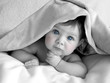 gorgeous baby under blanket