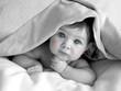 gorgeous baby under blanket