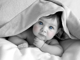 gorgeous baby under blanket poster